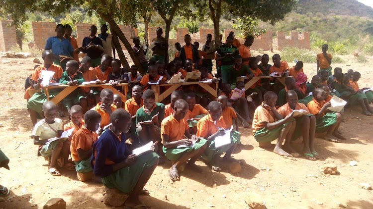 Pupils of Sukuk Pimary School learn under a tree last year