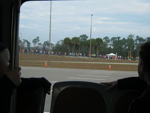 Photo: The boys and I caught a bus at 8:30, with hopes of seeing the runners before the finish line.  Here we are pulling up near Epcot and caught first glimpse of the race.