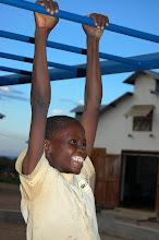 Photo: Village boy having a go on the monkey bar