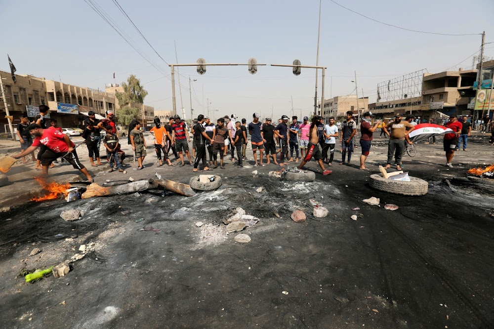 Ten minste 18 in Irak protesteer teen korrupsie en 'n gebrek aan werkgeleenthede