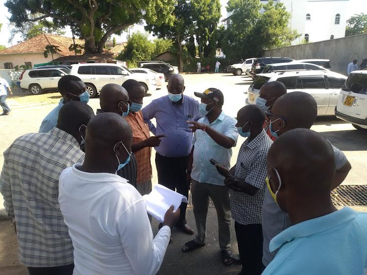 Kaloleni MP Paul Katana [in sandals] and the Gunga Mwinga burial committee at Mombasa Hospital on Monday.
