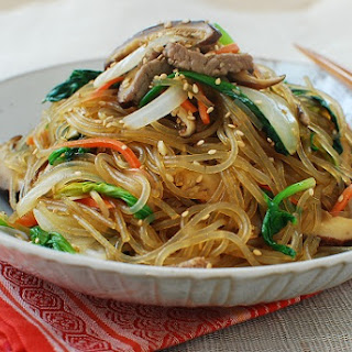 Japchae (Korean Stir-Fried Starch Noodles with Beef and Vegetables).