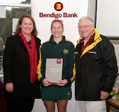 Photo: Mary at Doncaster Hockey Club presenting Sam Snow with the player of the match award