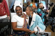Rapper Sho Madjozi is embraced by her mother Rosemary Phaweni as she arrives at the OR Tambo International Airport from Los Angeles  where  she bagged a BET award. / Thulani Mbele