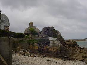 Photo: We move along the coast to the small town of Port Blanc, with this tiny 16th century watchtower on a rocky outcrop in the bay.