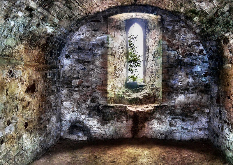 "Photo: I call this an accidental HDR. I had three shots taken in the Battle Abbey ruins, Battle, UK. They were handheld, noisy and of wildly differing focal lengths. I've always been disappointed by the quality of the shots, but I had a moment of inspiration to try something.  I brought all three photos into Photoshop as layers, auto aligned, then auto blended. After flattening, I ran HDR toning for the basic look. The background layer was duplicated and given a 30 px blur and set to Hard Light blend mode.  The window opening was selected on the background and put on its own layer and set to Multiply. There was some purple aberration around the window, so a Hue/Sat layer was applied just to the window to desaturate the purple.Battle Abbey ruins, Battle, UK - May 2007. ""Accidental"" HDR from three shots handheld and of wildly different focal lengths."