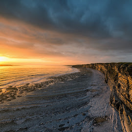 Calm before the storm by Russell Gurdin - Landscapes Beaches ( marcross seascape beach sunset )