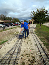 Photo: Gearld Lee putting away a passenger car set.       2013-1116 RPW
