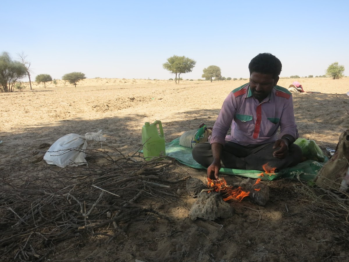 India. Rajasthan Thar Desert Camel Trek. Punja preparing the campfire for our lunch