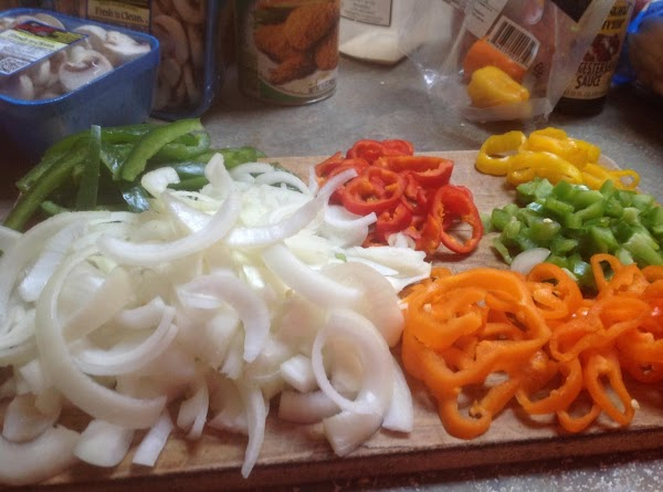 In the mean time slice sweet peppers into rings, and bell pepper into strips,...