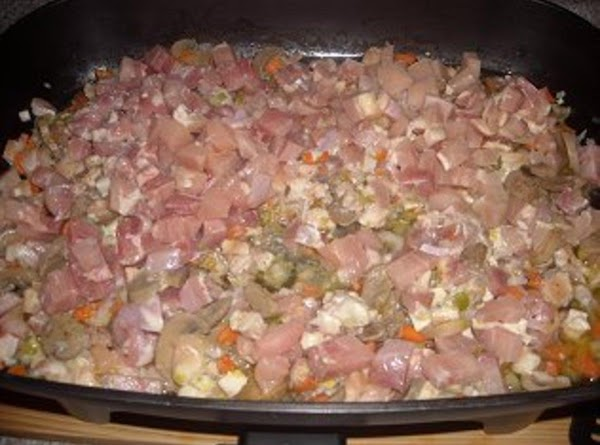 Add the meat as you cut it up as I said alternate cutting the...
