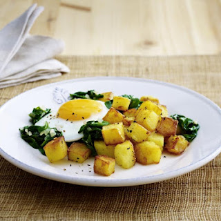 Fried Eggs with Sautéed Potatoes and Wilted Spinach.