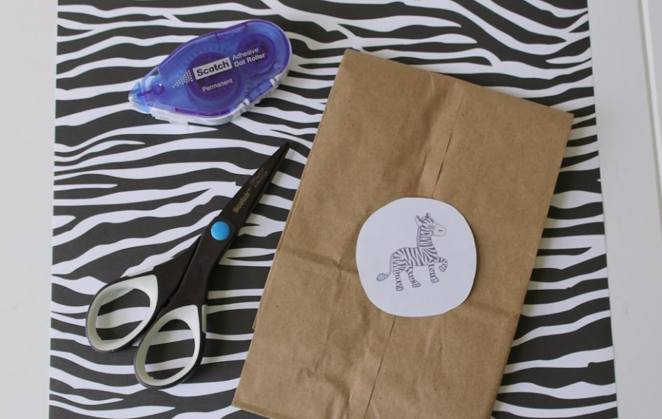 Supplies for DIY Safari Lunch Bags - animal-print scrapbook paper, scissors, a plain brown paper lunch bag, glue or tape, and my printable stickers/tags