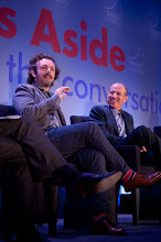 """Photo: Michael Sheen and Howard Gordon during the """"Hollywood and Policy"""" panel discussion Friday, Nov. 16 at the RAND Politics Aside event in Santa Monica."""