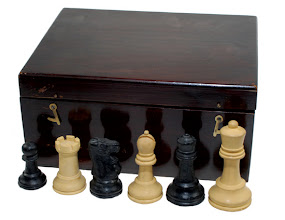 Photo: TAN set sold at Bloomsbury Auctions in 2007 (photo from their online catalogue)  Pawn is 4.6cm high (so, smaller than that in the 3.5in/8.5cm king height set, pawn=5.2cm) listed in the Bloomsbury auction Oct. 2004. Kings' bases stamped with the roundel. No mention/sign of crown stamps,  weighting or any label. It is not certain that this box was original to the set.
