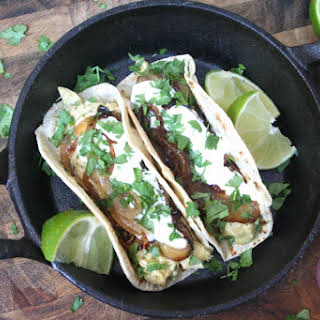 Tacos W. Shredded Chicken In A Spicy Poblano Cream Sauce Topped W. Caramelized Onions & Sour Cream.