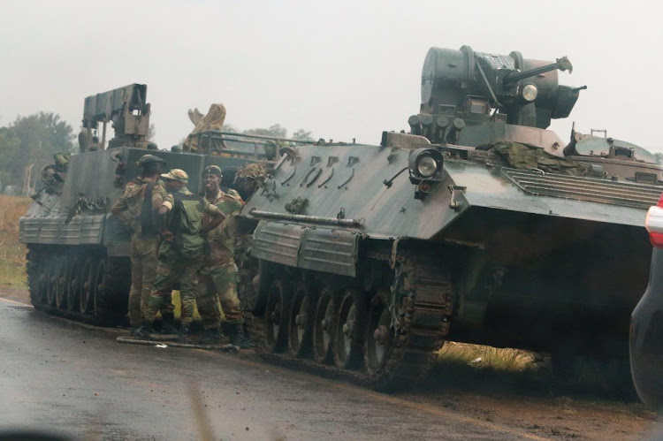 Soldiers stand beside military vehicles just outside Harare, Zimbabwe, on November 14 2017. Picture: REUTERS