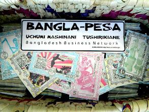 Photo: Bangla-Pesa and sticker ready to enter community. http://koru.or.ke