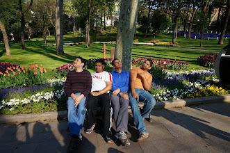 Photo: too many guys acting casual on a bench
