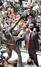 Photo: Former Chicago White Sox player Frank Thomas poses with a statue of himself during a ceremony before a baseball game between the White Sox and the Boston Red Sox in Chicago, Sunday, July 31, 2011. (AP Photo/Paul Beaty)