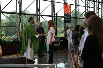 Photo: Hannah Kiefer, who will be serving as a GEO missionary in Hungary, is congratulated by President Harrison.