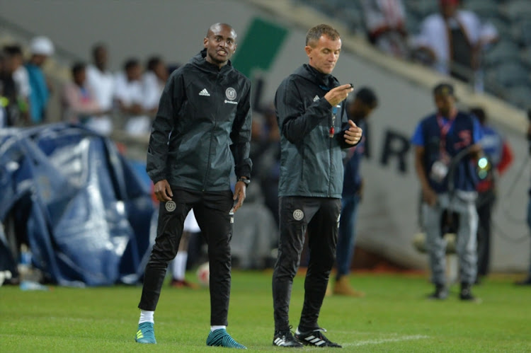 Orlando Pirates head coach Milutin Sredojevic (R) and his assistant Rhulani Mokwena (L).