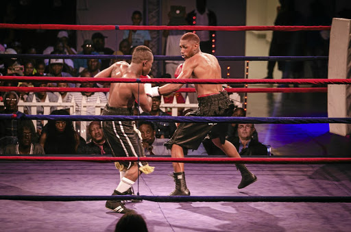 Thato 'Captain Charisma' Bonokwane, right, tags Samuel Esau with a jab during their bout in Kagiso at the weekend.