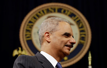 Photo: WASHINGTON, DC - MAY 28:  U.S. Attorney General Eric Holder speaks during a naturalization ceremony at the U.S. Department of Justice May 28, 2013 in Washington, DC. During the event Citizenship and Immigration Services Director Alejandro Mayorkas administered the Oath of Citizenship to approximately 70 new U.S. citizens.  (Photo by Win McNamee/Getty Images)