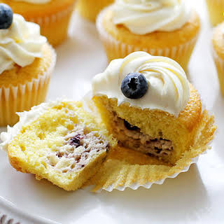 Blueberry Cheesecake-Stuffed Lemon Cupcakes with Vanilla Frosting.
