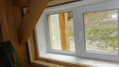 """Photo: Scrap wood spacer/shims carry foam plane out to edge of sill to support the birch ply & the 5""""-wide cherry nose."""