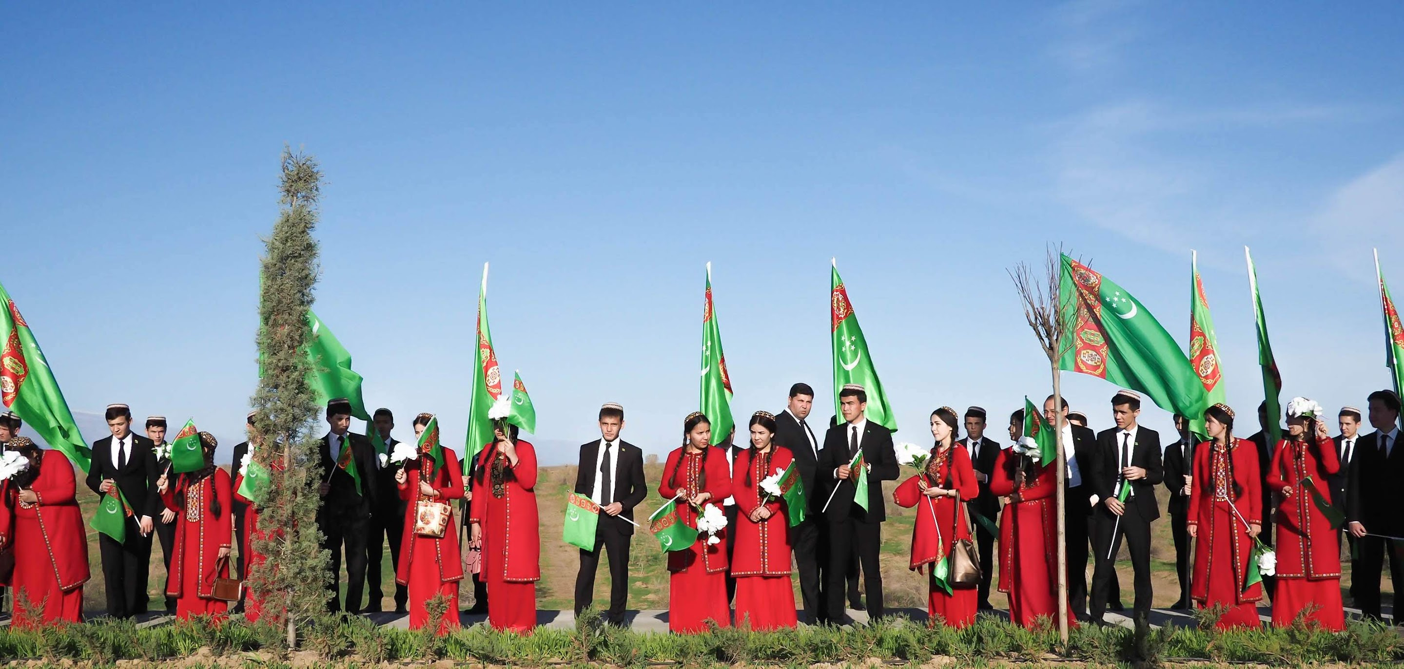 Line of Turkmen students ready to welcome the president to the Nowruz Festival