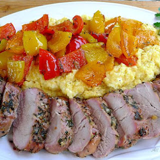 Grilled Whole Pork Tenderloin With Colored Peppers Over Polenta.