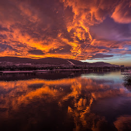 Sunset by Geir Blom - Landscapes Cloud Formations ( cloud, sunset, winter, river, water )