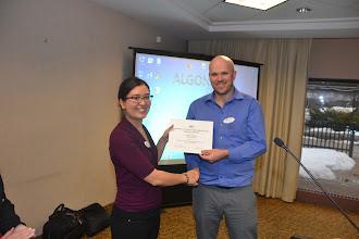 Photo: Adrianne presenting a grant to William O'Brien (Carleton Professor)