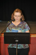 Photo: Laura Lee Bennett reads one of her poems in the anthology.