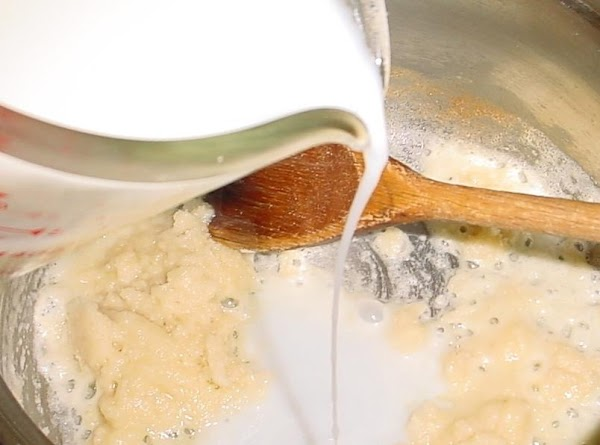 2 Cups  of broth and 2 cups of milk, Cook till thickened-VERY thick!...