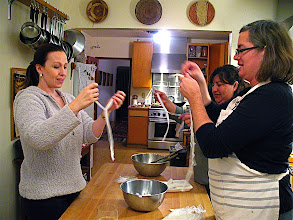 Photo: Heather, Dea & Sofia pulling noodles