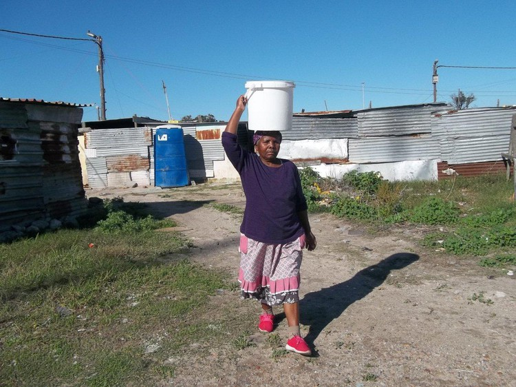 Margaret Mbotshana has received an R18,581 water bill, but has no tap or water supply in her shack and has to carry water herself.