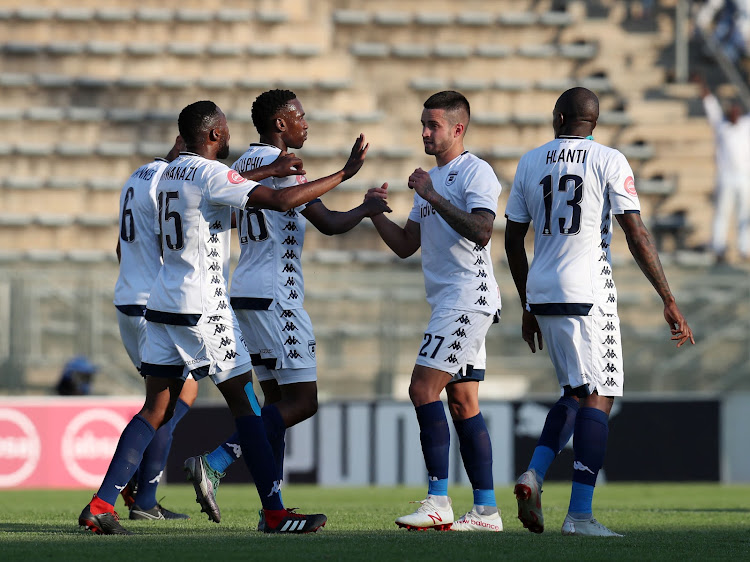 Bidvest Wits midfielder Keegan Ritchie celebrates with teammates after scoring the equaliser during the 1-1 Absa Premiership draw away at champions Mamelodi Sundowns at the Lucas Moripe Stadium in Atteridgeville, west of Pretoria, on October 7 2018.