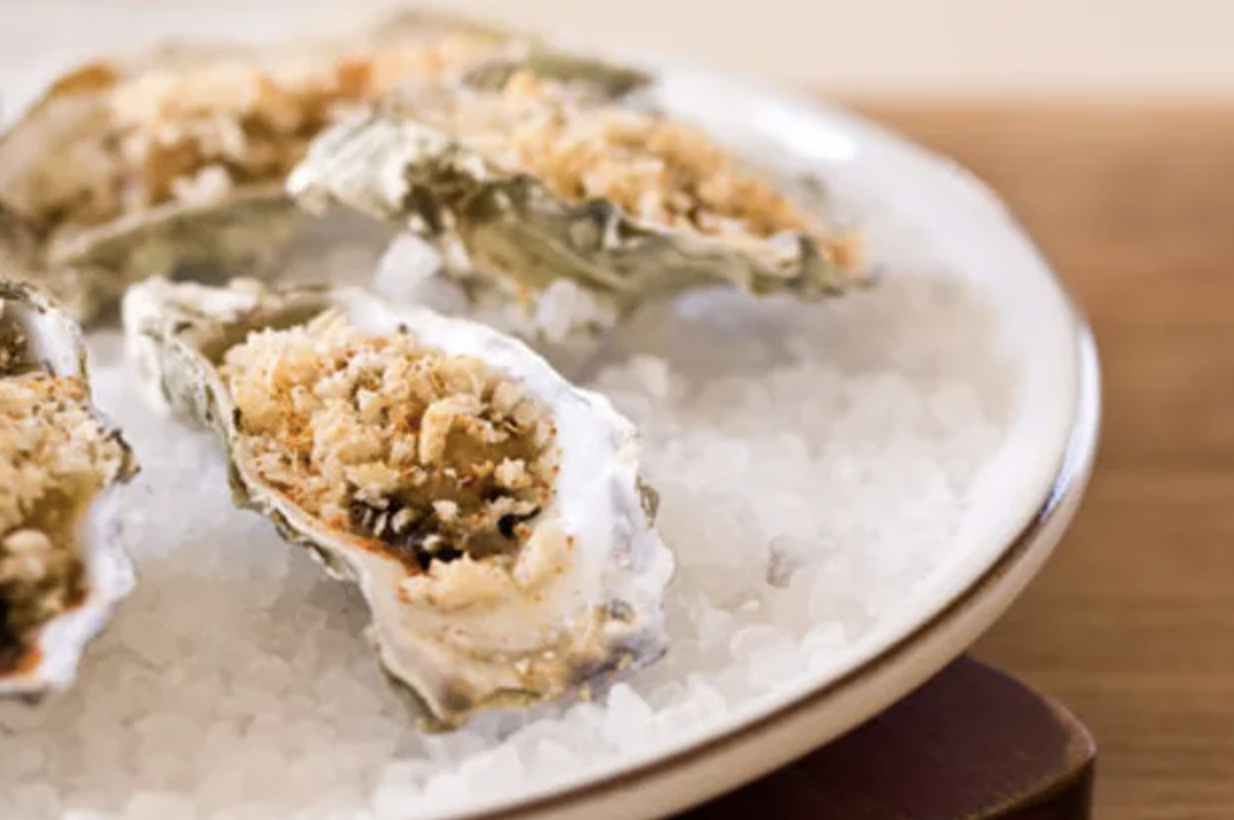 Oysters Bienville served over a plate of ice