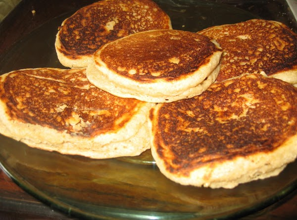 For each pancake, spoon 1/4 cup of batter onto the surface and cook until...