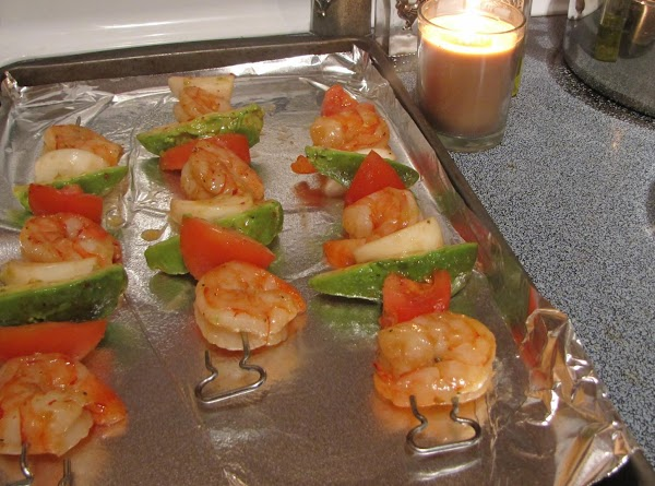 Carefully remove the baking pan from the oven and place the skewers on a...