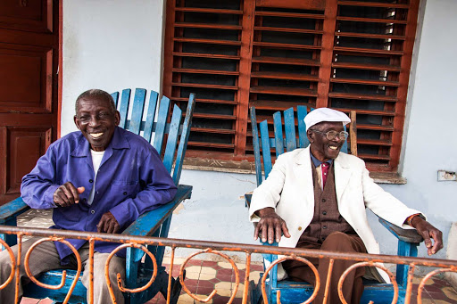 Cuba-Two-Old-Men-Sitting-in-Blue-Deck-Chairs.jpg - Meet local residents in Cuba as part of a cultural exchange.