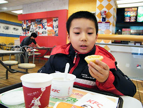 Photo: reunited son, warrenzh 朱楚甲 after blizzard I burst him for his loose management over his game gears from the bad influence his messy and fussy mom's. We treated ourself rich KFC, which also buffeted from supply scandal within PRC market. here son ate KFC breakfast after a night ported in his dad, benzrad's QRRS dorm.