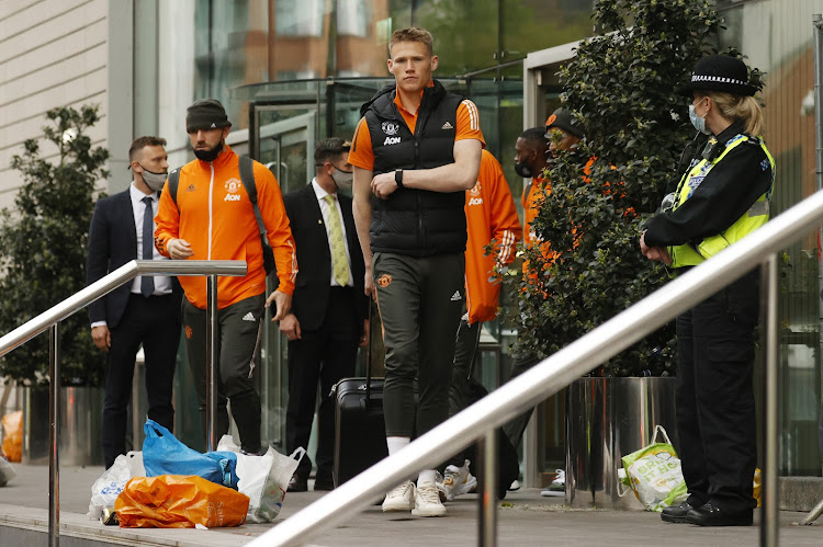 United's Scott McTominay leaves the hotel as Manchester United fans protest against their owners after the game is postponed