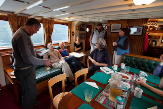 Photo: Inside the ship's salon.  Rick is presenting Ross with a fine bottle of scotch, complete with limerick.