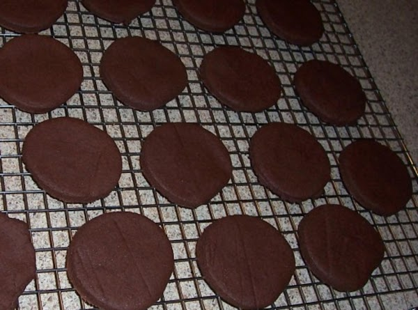 Transfer to a wire rack and let cool. Fill cookies with Peppermint Cream Filling....