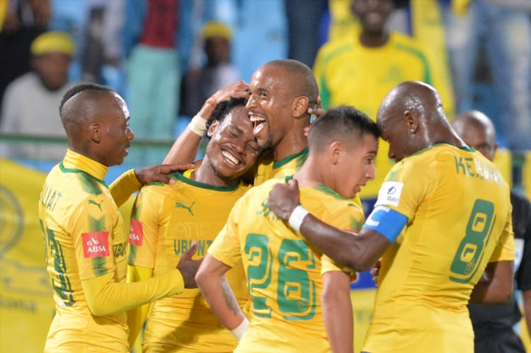 Percy Tau of Mamelodi Sundowns celebrates his goal with teammates during the Absa Premiership match between Mamelodi Sundowns and Chippa United at Loftus Versfeld Stadium on April 04, 2018 in Pretoria, South Africa.