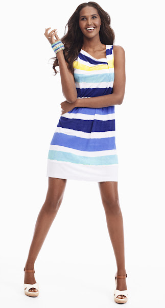 Photo: A simple dress gets brightened up with cheery stripes. Play up the happy pattern with a bracelet that's subtly striped too.