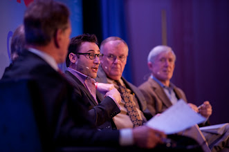 """Photo: Simon Sinek responds to a question during the closing conversation, """"Leadership for the Future: Where Will It Come From?"""" Saturday, Nov. 17 at the RAND Politics Aside event in Santa Monica. Panelists Admiral James Loy and Under Secretary Robert Hormats are on the right."""